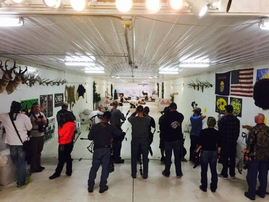Shooters in an archery league compete at 3D Archery
