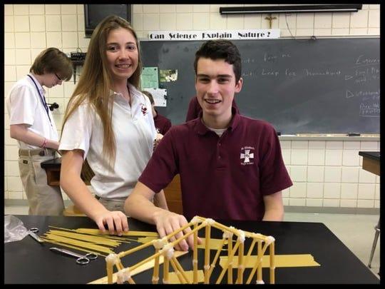 St. Elizabeth High School seniors Leighton Trimarco (left) and Eric Bristol, engineering students of science teacher Frank Bellomo,built pasta-spaghetti bridges to determine how to build stronger structures.