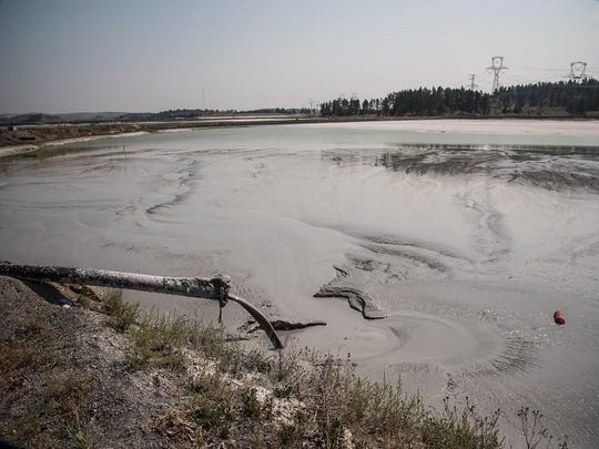 Coal ash waste being disposed of as wet sludge. Montana regulators have given conditional approval to plans to inject clean water underground around the city of Colstrip to flush out water reserves polluted by coal ash from the small southwestern community's namesake power plant