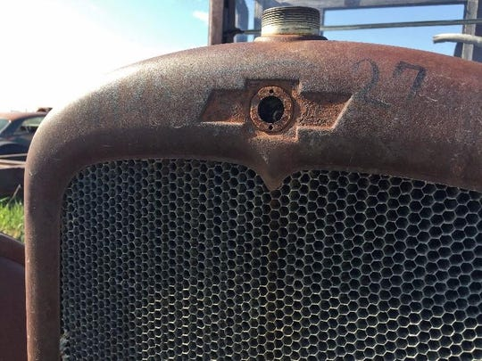 """A Chevrolet is marked """"1925-27"""" at the Rustless in Montana yard east of Cut Bank."""