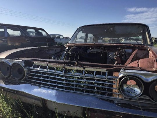 A Buick Special missing its hood sits at the Rustless in Montana yard east of Cut Bank.