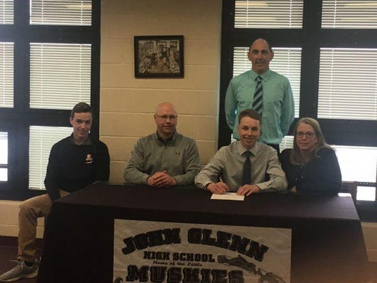 John Glenn's Derek Graham signed to golf for West Liberty on Thursday afternoon. Graham was the Muskingum Valley League Golfer of the Year this season, while also earning first team East District honors. He was a three-year letterman for the Muskies, who won back-to-back MVL Championships.Pictured are Sitting (Left to Right): Brady Graham (brother), Justin Graham (father), Derek Graham, Lorrie Graham (mother); and standing is high school head golf coach Chad Orecchio.