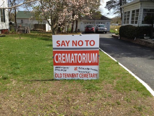 A sign that was staked out in a residential yard next to the Old Tennent Church in April was opposed to the building of a crematorium on the cemetery property.