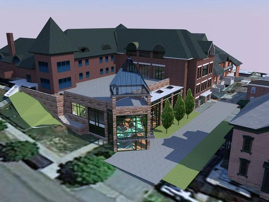 Artist's rendering of the planned Center for Communi- cations and Creative Media at Champlain College, facing south from Maple Street.