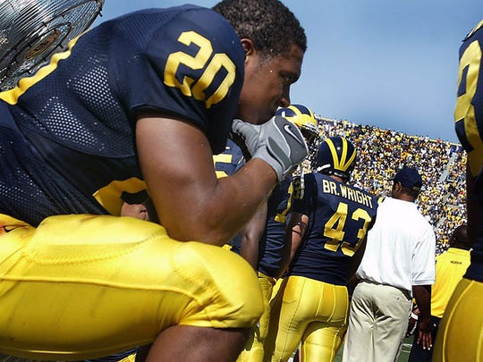 Mike Hart sits on the bench near the end of U-M's loss to Appalachian State on Sept. 1, 2007.