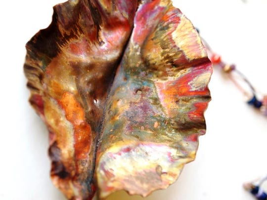 The center of an annealed, fold-formed and hammered leaf pendant.