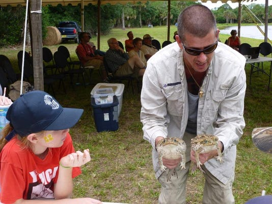 Bailey Walker learns about invasive cane toads at the second annal (2013) WO.JPG
