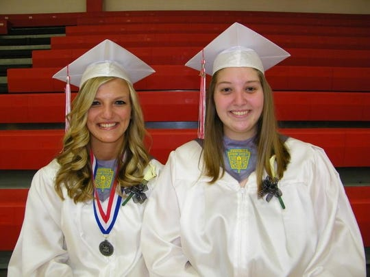 Erica Eskins, right, was a valedictorian with Allison McKinney, left, in the Bellevue High School class of 2014.