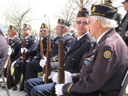 Members of the Honor Guard, American Legion Post #73, wait before delivering a 21-gun salute during Saturday's dedication ceremony for Veteran's Memorial Park.