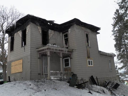 The home at 218 W. Cortland St., Groton was destroyed by a fire Feb. 16. Damage outside the windows of a Groton home has the shape that appears to home owner Renee Brehm like angel's wings.