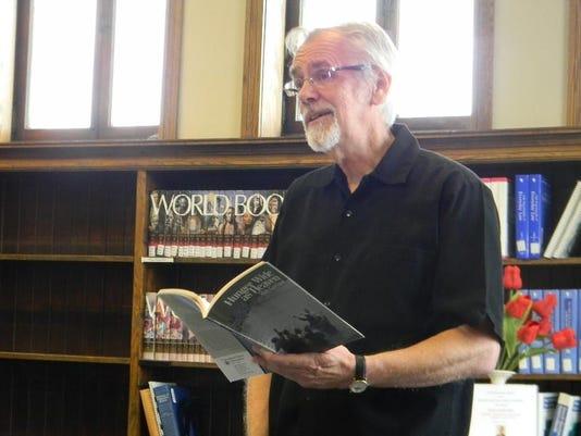 Max Garland reads form book.JPG