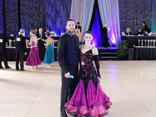 Sean Mulhern and Elizabeth Malady of Belevidere take part in a ballroom dancing competition.