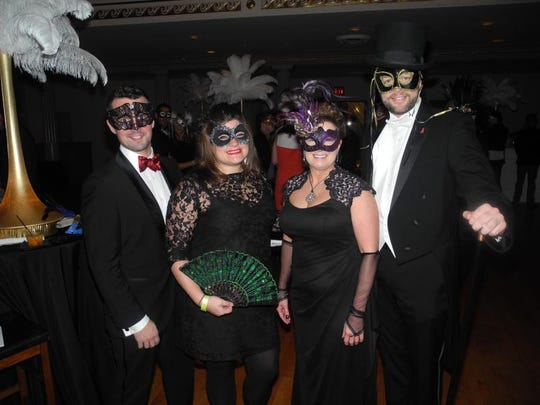 Avant Garde co-chairs Wes Davis, left, Susan Torregrossa, Connie Ford and Brad Pinson at Avant Garde Masquerade Ball, a fundraiser for Nashville CARES, held at War Memorial Auditorium.