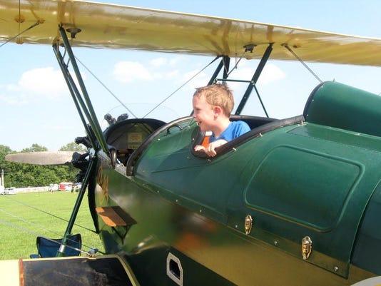 kid in plane 1.jpg