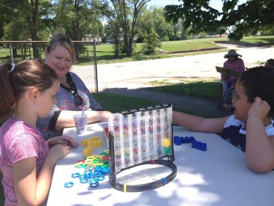 Kids and volunteers enjoy a game.JPG