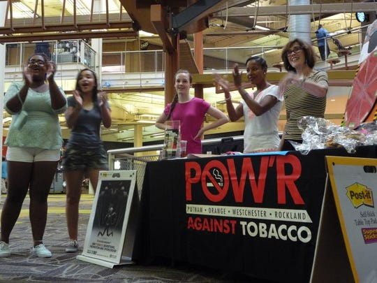 Members of POW'R Against Tobacco visited the Palisades Center in West Nyack. Denise Hogan, right, is a coordinator for POW'R Against Tobacco, a program of the American Lung Association of the Northeast.