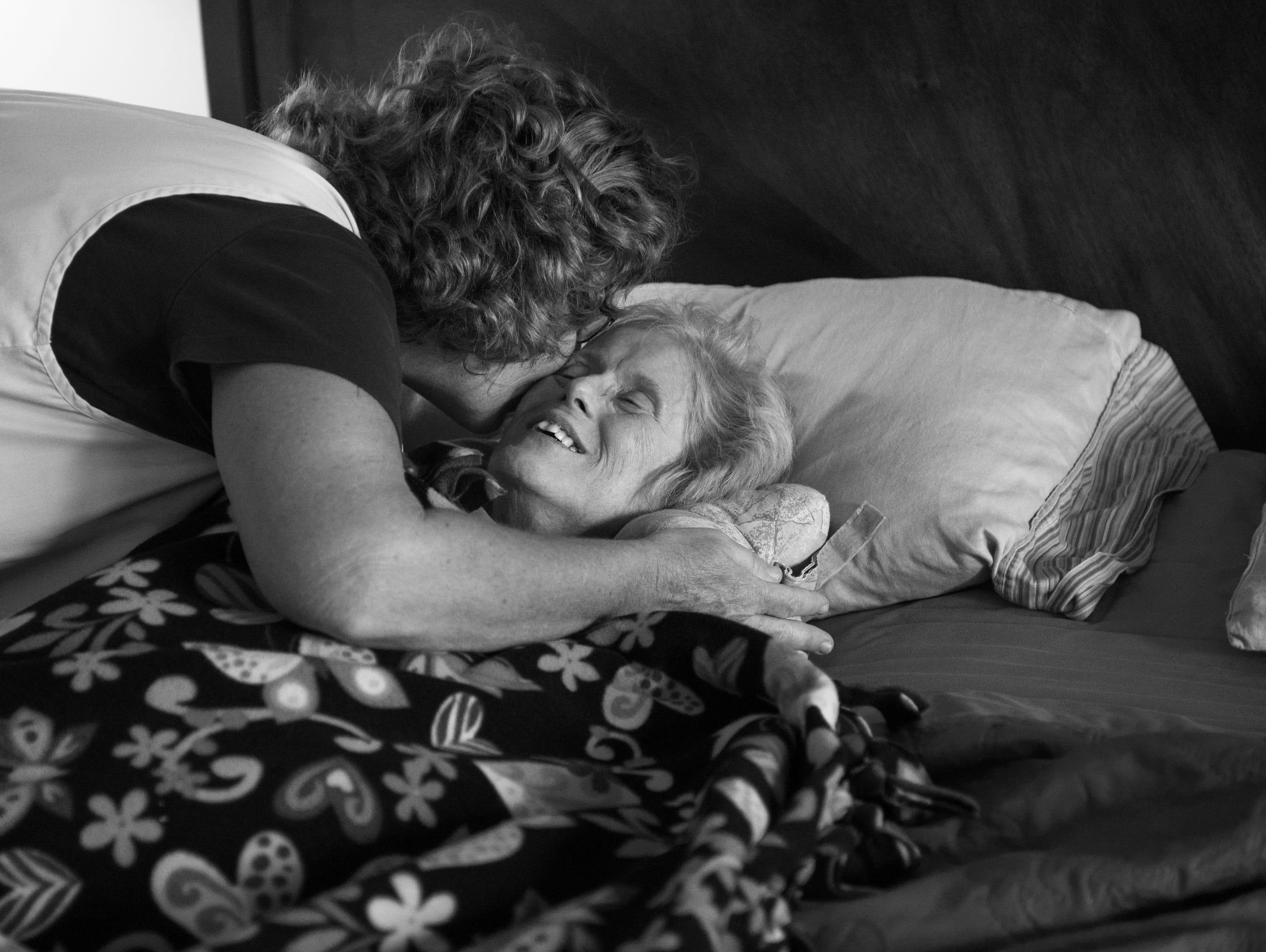 Deaconess VNA hospice nurse Sharon Stoltz hugs and