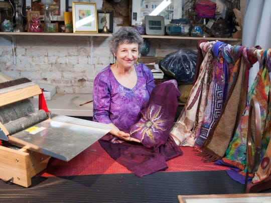 Lisa Jacenich, owner of Artful Gifts in Staunton, poses