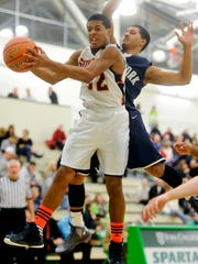 York Suburban's Manny McDowell pulls down the rebound in front of West York's Roque Lopez on Saturday night during the boys' game of the inaugural Donnie Swartz Memorial Classic. (Daily Record/Sunday News -- Chris Dunn)
