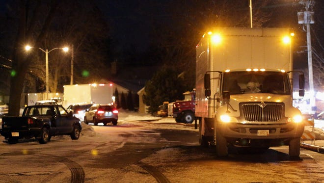 Emergency trucks gather near the North 3rd Street pumping station on North Avenue Friday January 22, 2016 in Sheboygan. A decades-old sewerage pipe leaked its contents partially into Lake Michigan.