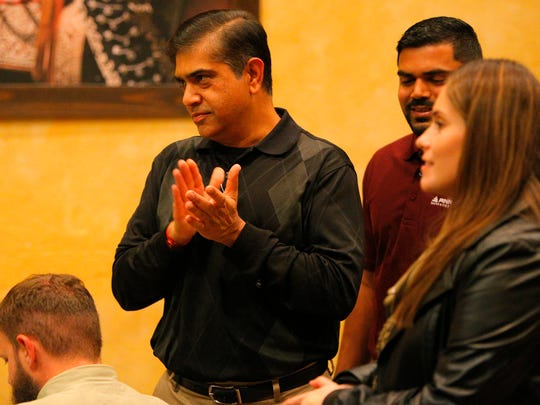 Neil Patel, left, greets supporters at La Casa Del Sazon in Salinas on Tuesday.