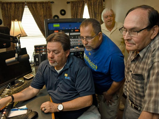 Gregg Hoover, left, works the soundboard during a meeting with Mike Montedoro, Garry Kline and Wade Burkholder at the new radio station WRRG in Greencastle Friday, June 10, 2016. The station will go on the air Tuesday.