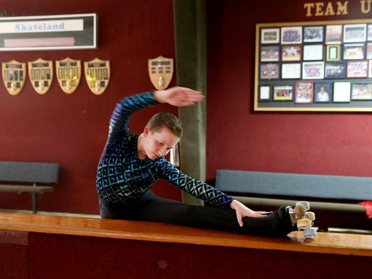 Gauge Phillips of the Sk8town Stars stretches before practice at Skateland in East Bremerton.
