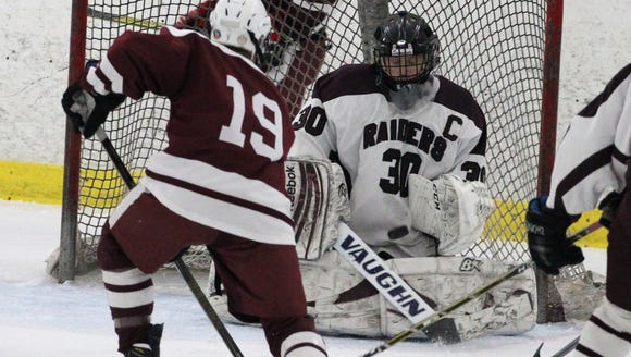 Fordham Prep's Ryan Gilchrist shoots on Scarsdale goalie