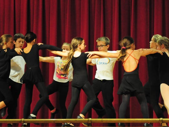 In preparation for performing at this Saturday's Ukrainian Festival, students at the Iskra Ukrainian Dance Academy in Whippany are shown at a Sept. 22 rehearsal.