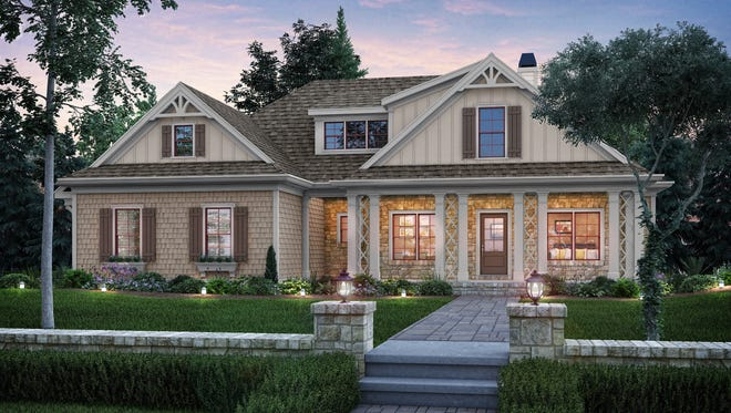 Elegant lattice columns draw all eyes to the front porch of this cottage design.