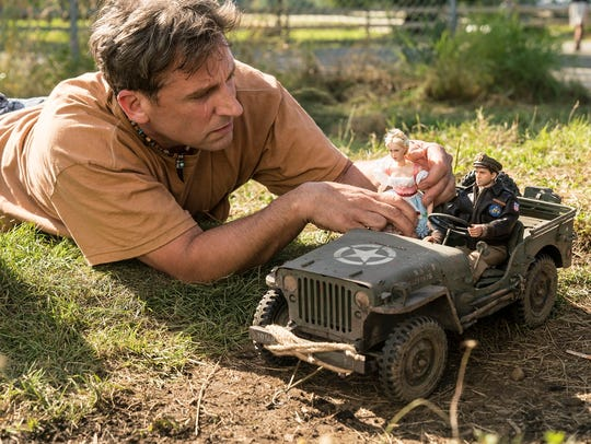 "Mark Hogancamp (Steve Carell) photographs the dolls for his fictional town in ""Welcome to Marwen."""
