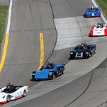 Sports racing cars compete during July's SCCA Majors Super Tour event on a concrete patched section of the Watkins Glen International track entering Turn 11.