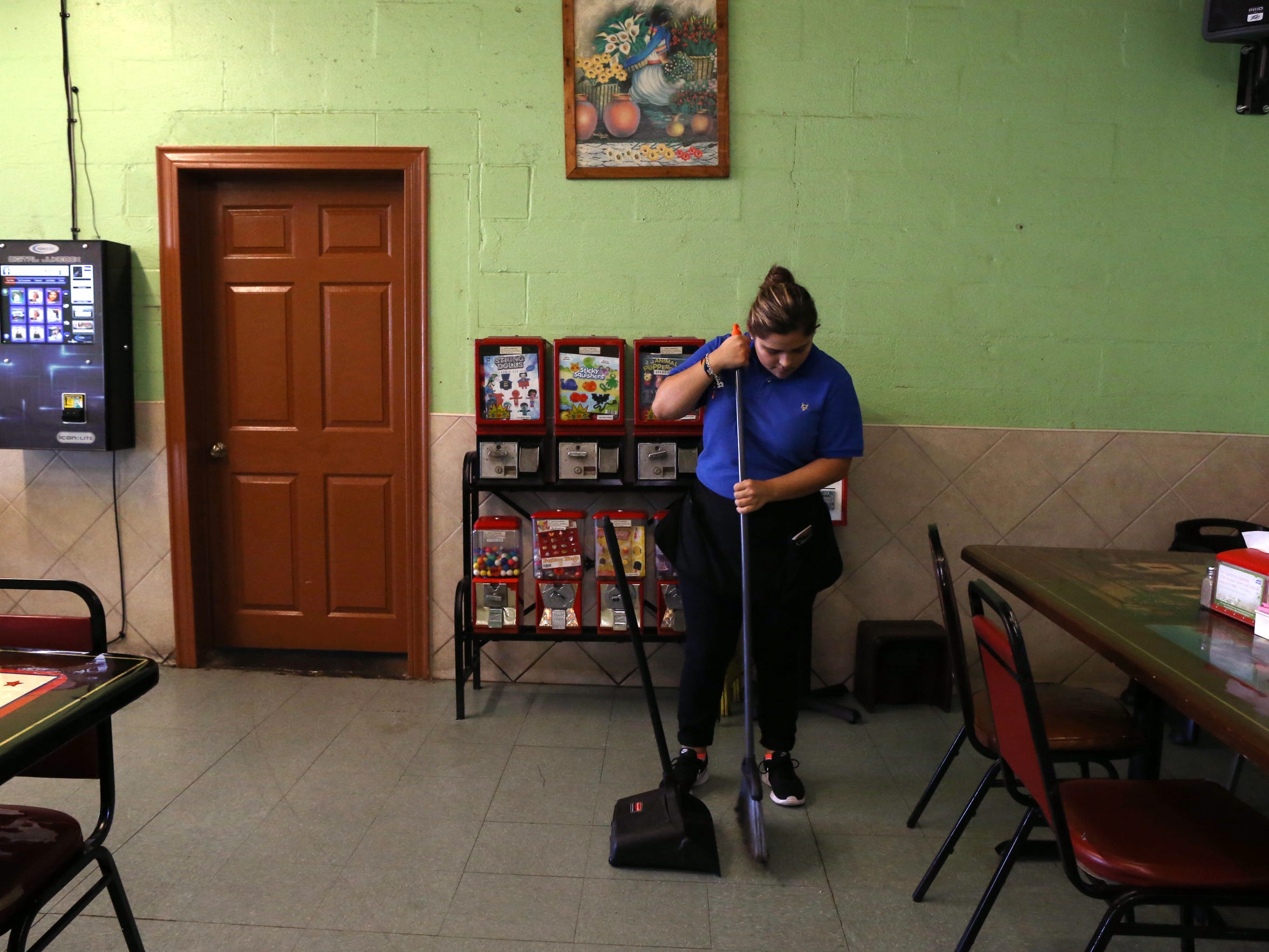 Claudia Jimenez, 19, cleans up the restaurant where she works on October 18, 2017. Jimenez hopes sharing her experience will help other DACA recipients, who may have the same fears and worries, will come forward and ignite change.