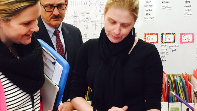 Chatsworth Avenue School Principal Katie Anderson, left, and Mamaroneck Superintendent Robert Shaps confer with second-grade teacher GenineMarie DiFalco during a classroom visit Feb. 11