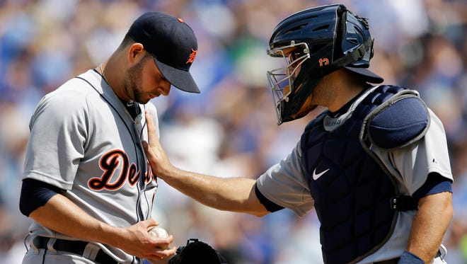 Detroit Tigers catcher Alex Avila, right, talks with starting pitcher Anibal Sanchez, left, after allowing a run to score during the seventh inning of a baseball game against the Kansas City Royals at Kauffman Stadium in Kansas City, Mo., Sunday, May 3, 2015.