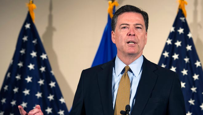 FBI Director James Comey makes a statement at FBI headquarters in Washington on July 5, 2016.
