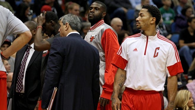 Bulls guard Derrick Rose (1) looks on during the second quarter against the Minnesota Timberwolves at Target Center.
