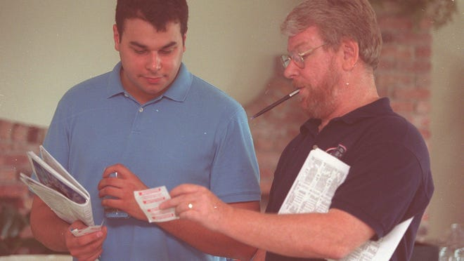 Long-time Asbury Park Press columnist Bill Handleman (right), who gave the Haskell Invitational a strong voice over the years, is shown talking horses with Dan Kaplan at Monmouth Park in 2002.
