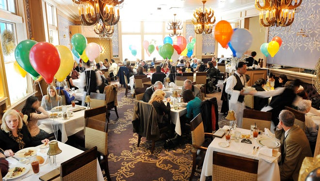 Commander's Palace in New Orleans is justifiably famous for its brunch with balloons and rich Creole dishes like crawfish etouffee.