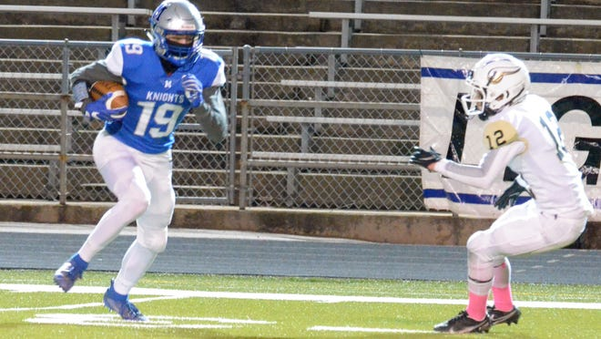 McCallum receiver Nate Davidson heads for the end zone as Navarro defensive back Mason Cuellar tries to change directions in the second quarter of Thursday's game at Nelson Field. Davidson made a juggling catch of Jaxon Rosales' pass and turned it into a 52-yard touchdown.