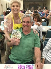 Jim Schmitt of Bettendorf, IA, (with Bingo committee
