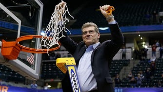 Connecticut coach Geno Auriemma celebrates after the Huskies beat Syracuse to win the NCAA title.