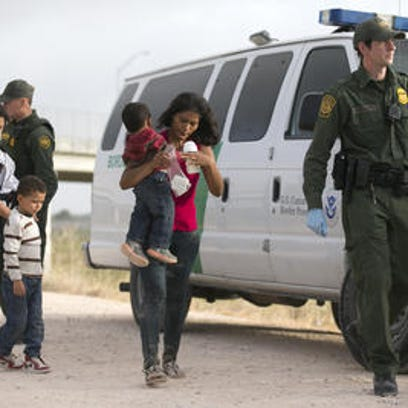 Illegal migrants are picked up in Texas in June.