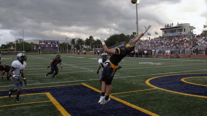 Naples TE Chris Hanlon goes up for the catch against North Miami for the spring classic at Staver Field on Friday, May 20, 2016. (J. Scott Butherus/Staff)