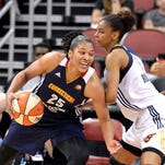 Connecticut's Alyssa Thomas, left, attempts to drive through the defense of Indiana's Briana Butler during their game Saturday, May 23, 2015, at the KFC Yum! Center. (Photo by Timothy D. Easley/Special to the C-J)