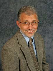Dr Thomas Arnone.