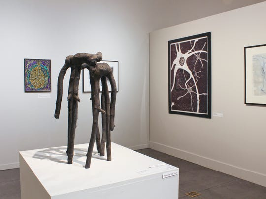 """Sculpture in foreground is titled """"Cage Three"""" by David Gentry, which won first place at the West Coast Biennial at Turtle Bay."""