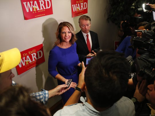 Sen. Rand Paul and Kelli Ward speak to the press at