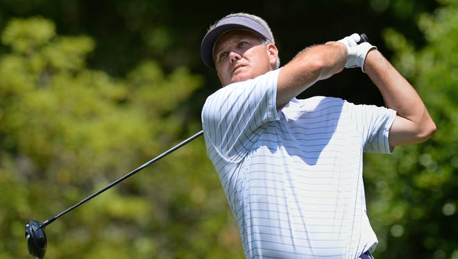 Lee Palms hits from the 9th tee during the 2nd round of the Carolinas Golf Association Carolinas Amateur Championship Friday, July 11, 2014 at the Greenville Country Club Chanticleer Course.