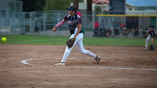 Pitcher, Mariah Estrada, junior, of La Quinta High School strikes out an Aztecs player during Thursday night's Desert Valley League title game.